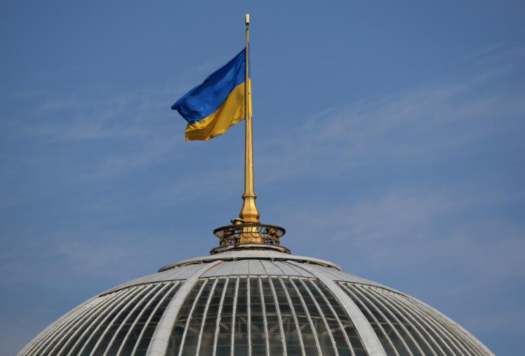 A Ukrainian national flag flies over the Verkhovna Rada building in central Kiev